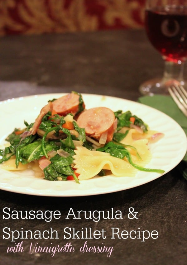 Lite, healthy meal with sausage, arugula, spinach and pasta.