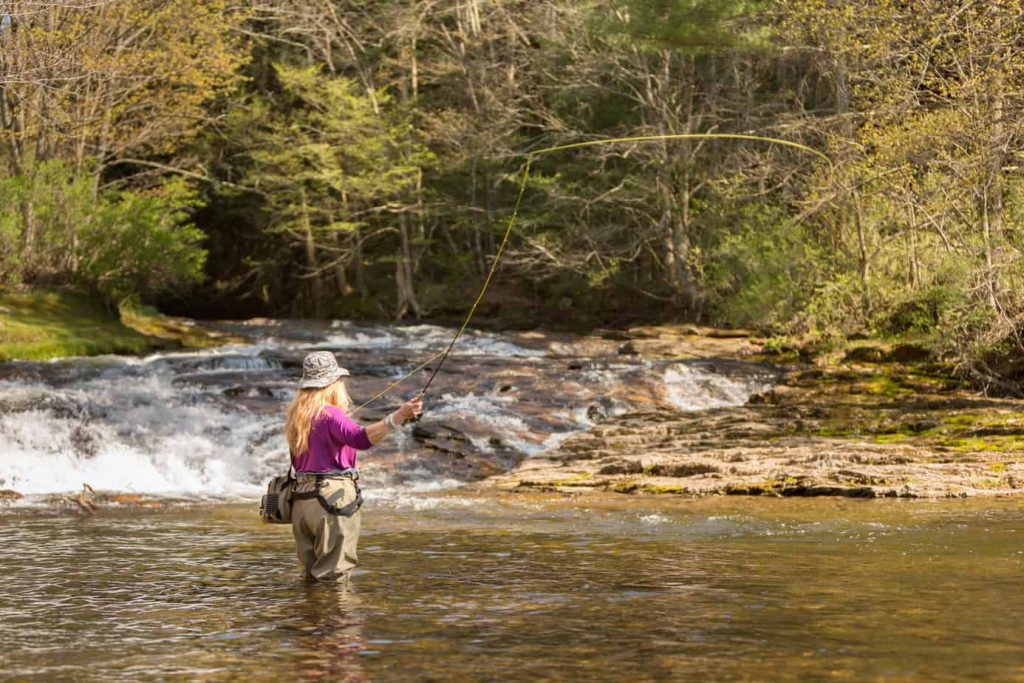 A woman fly fishing