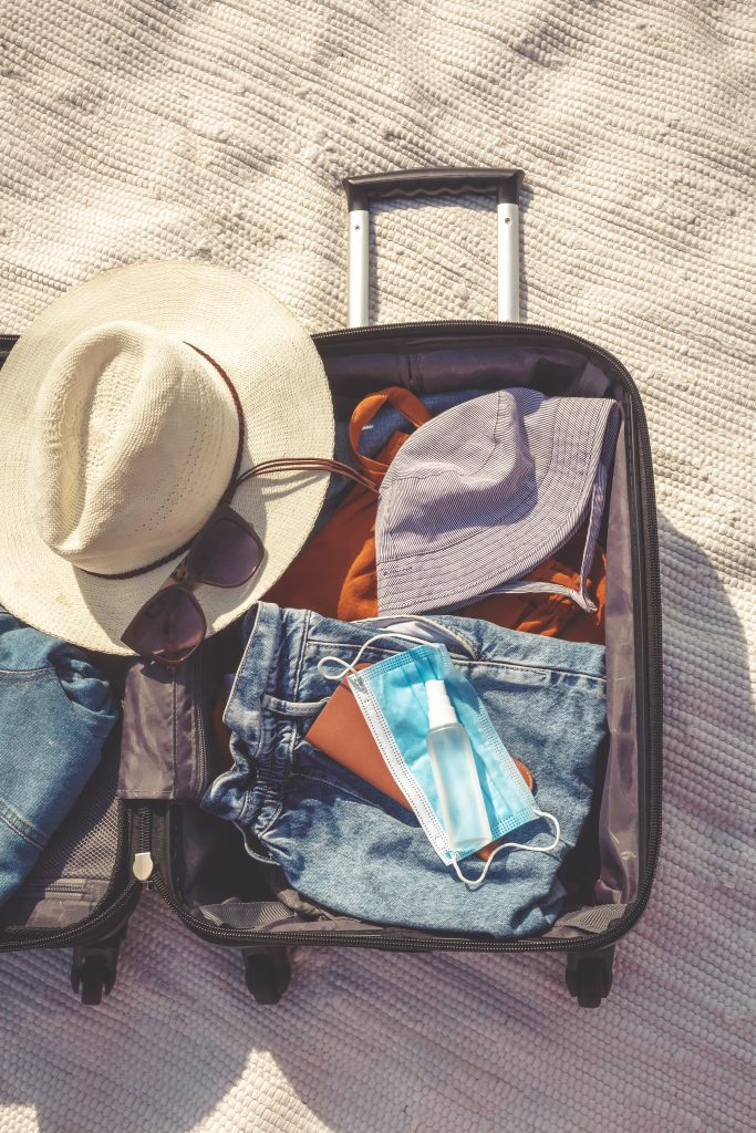 A suitcase packed for vacation