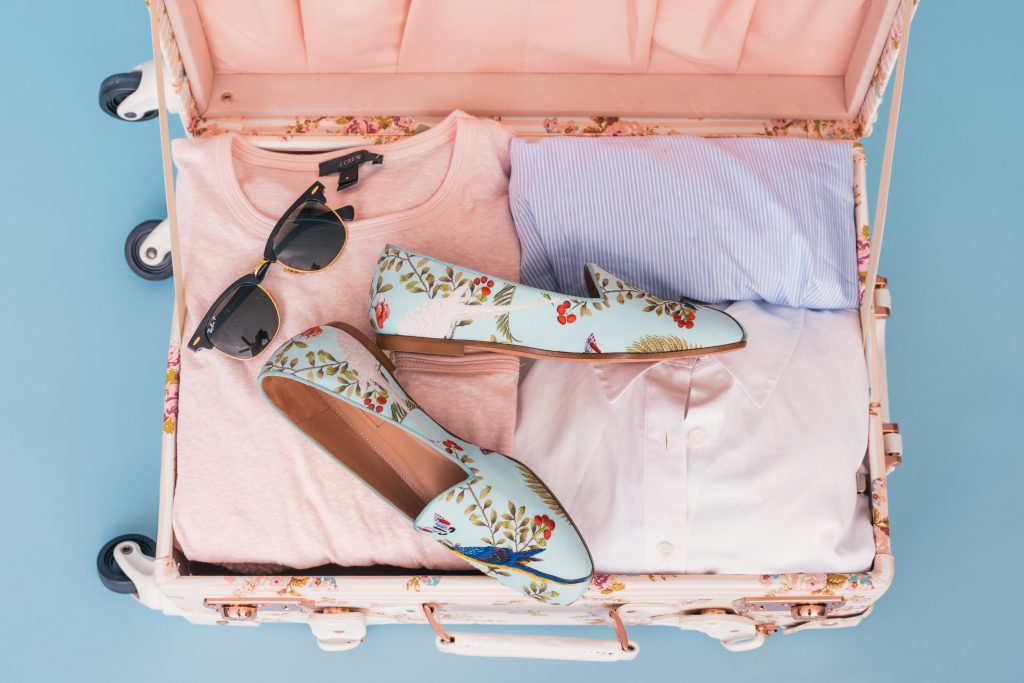 A packed pink carry on suitcase