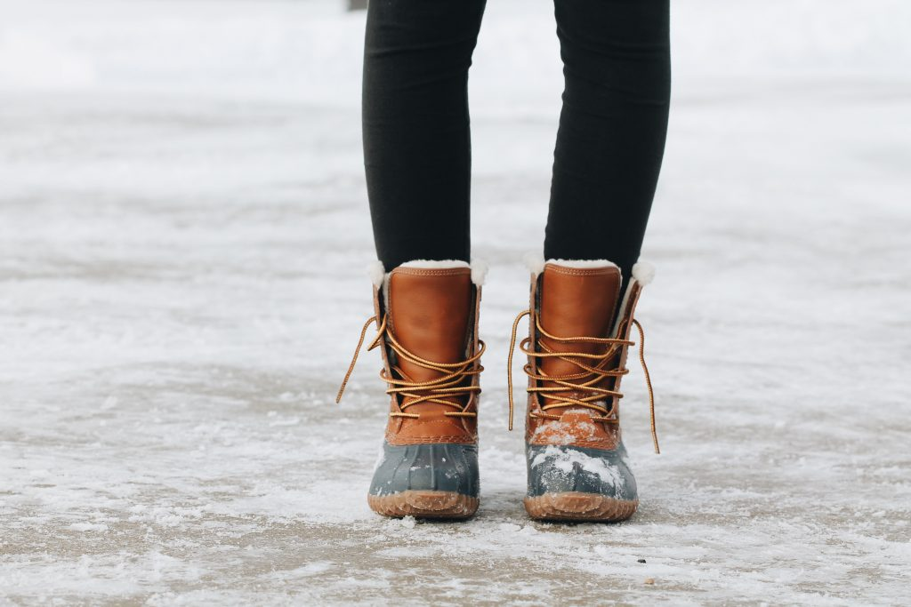 A girl wearing snow boots