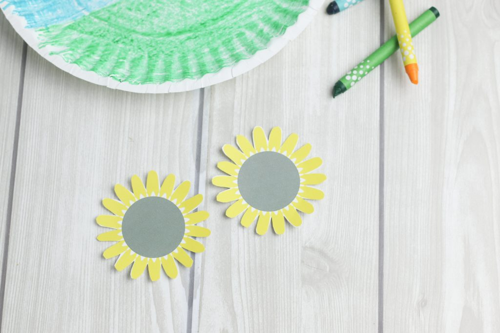 Two paper sunflower blossoms from a free printable template