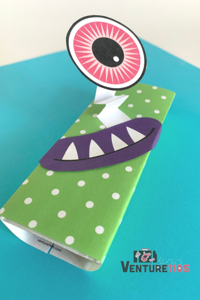 A candy bar wrapped up to look like a cute monster using a free printable monster kit