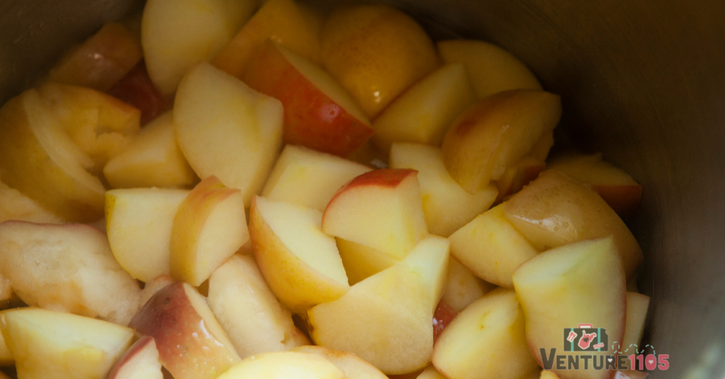 Diced apples cooking in a pot