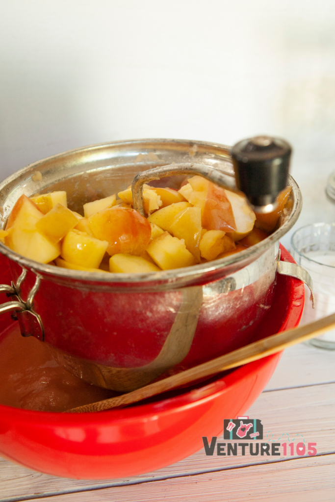 Using a food mill to process applesauce